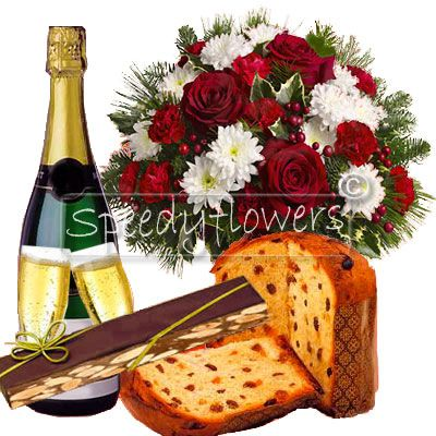 Bouquet of flowers with Christmas cake, sparkling wine and nougat