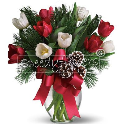 Bouquet for Christmas with tulips and fragrant green