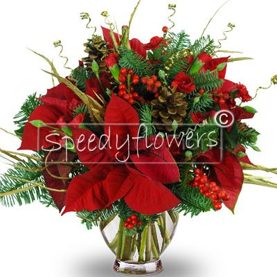 Bouquet of flowers with poinsettias and Christmas decorations