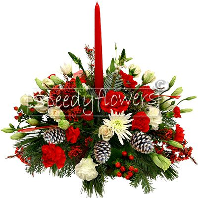 Centerpiece for Christmas with flowers and berries