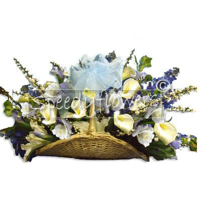 Composition in the basket with Calla Lilies, white Roses and blue flowers