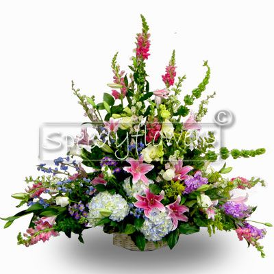 Composition in basket with flowers of various colors