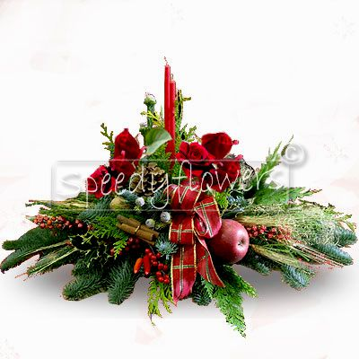 You can give a greetings Christmas centerpiece arrangement.