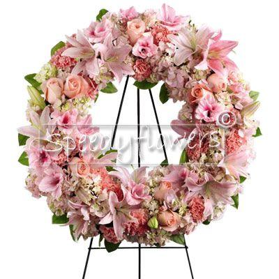 Corona funebre con fiori rosa