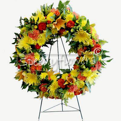 Corona funebre con fiori di colore giallo e arancione