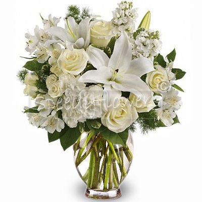 Blaze of white flowers suitable for a bereavement