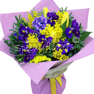 Bouquet with mimosa and blue flowers